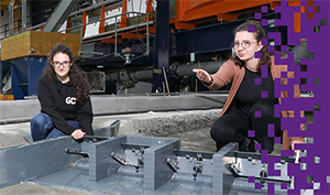 Méryl Schopfer and Julie Devènes, Master's students in Civil Engineering at the EPFL, in the hydraulic hall where a dam project on the Rhône is being tested. © 2021 Alain Herzog